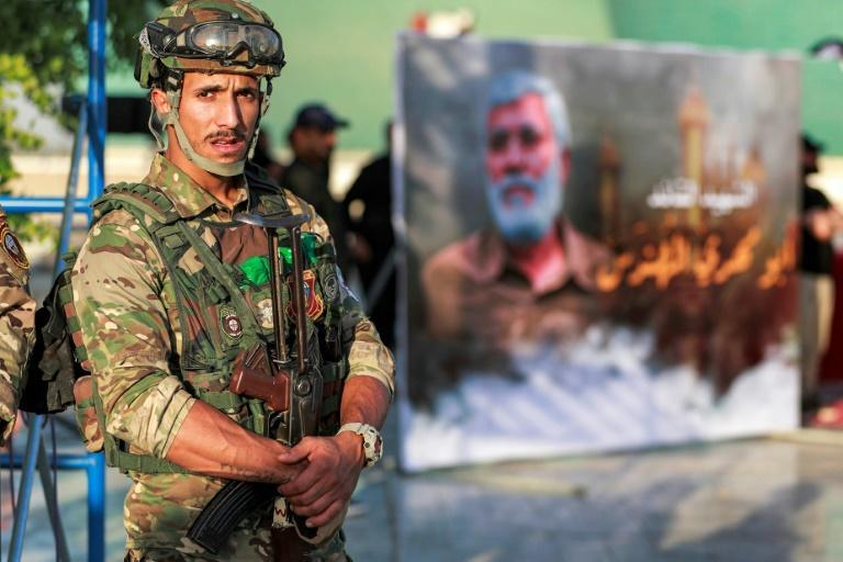 A member of Iraq's Hashed al-Shaabi (Popular Mobilisation) paramilitary forces stands guard during an election rally for the Asaib Ahl al-Haq movement in Baghdad on October 7, 2021 (AFP/AHMAD AL-RUBAYE)