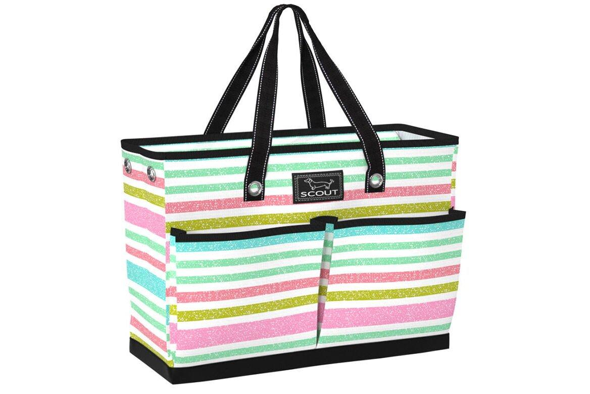 "<p><strong>Buy it: </strong><a href=""https://www.scoutbags.com/the-bj-bag-off-tropic-pocket-tote-bag"" target=""_blank"">Scout BJ Bag, $55 </a></p> <p>This handy tote has four exterior and two interior pockets for stashing all your necessary beach gear and is made with an all-weather fabric that makes clean up easy—you can even hose it off. It zips closed and features an interior zip pocket where you can stash keys, phones, and cash, and it comes in a variety of coastal colors and pretty patterns.</p>"