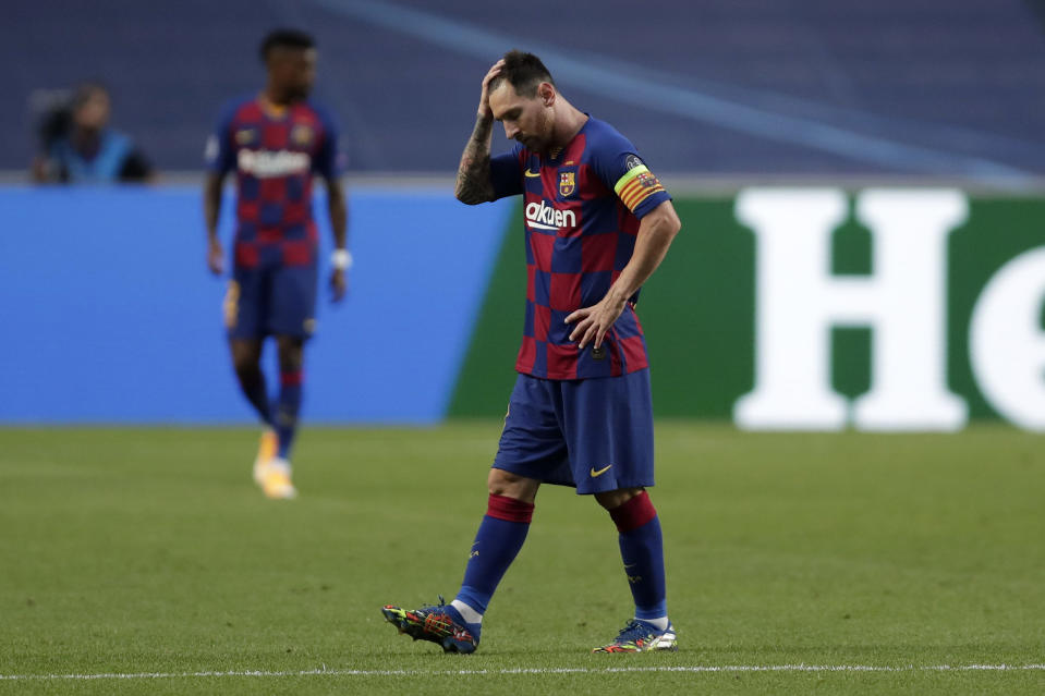 LISBON, PORTUGAL - AUGUST 14: Lionel Messi of FC Barcelona looks dejected after his team concede during the UEFA Champions League Quarter Final match between Barcelona and Bayern Munich at Estadio do Sport Lisboa e Benfica on August 14, 2020 in Lisbon, Portugal. (Photo by Manu Fernandez/Pool via Getty Images)