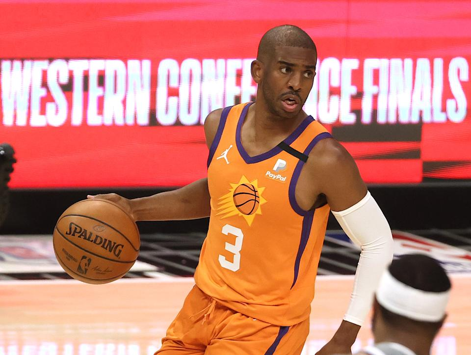 LOS ANGELES, CALIFORNIA - JUNE 26: Chris Paul #3 of the Phoenix Suns brings the ball up court against the LA Clippers in game four of the Western Conference Finals at Staples Center on June 26, 2021 in Los Angeles, California. NOTE TO USER: User expressly acknowledges and agrees that, by downloading and or using this photograph, User is consenting to the terms and conditions of the Getty Images License  (Photo by Ronald Martinez/Getty Images)