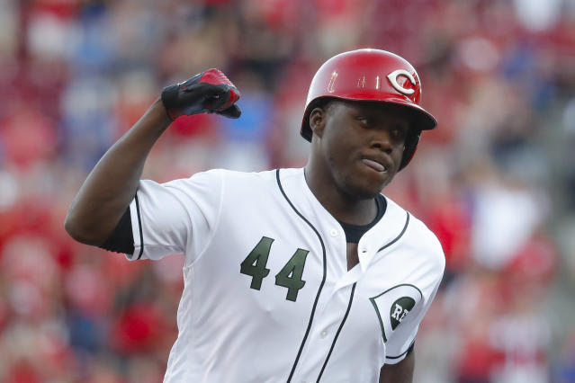 Cincinnati Reds' Aristides Aquino runs the bases after hitting a two-run home run off Chicago Cubs starting pitcher Yu Darvish in the second inning of a baseball game, Friday, Aug. 9, 2019, in Cincinnati. (AP Photo/John Minchillo)