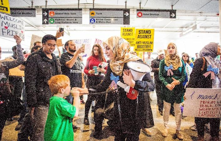 Demonstrators gather for a protest against the executive order by US President Donald Trump, banning immigrants from seven majority-Muslim countries, at Los Angeles International Airport, on February 4, 2017 (AFP Photo/Kyle Grillot)