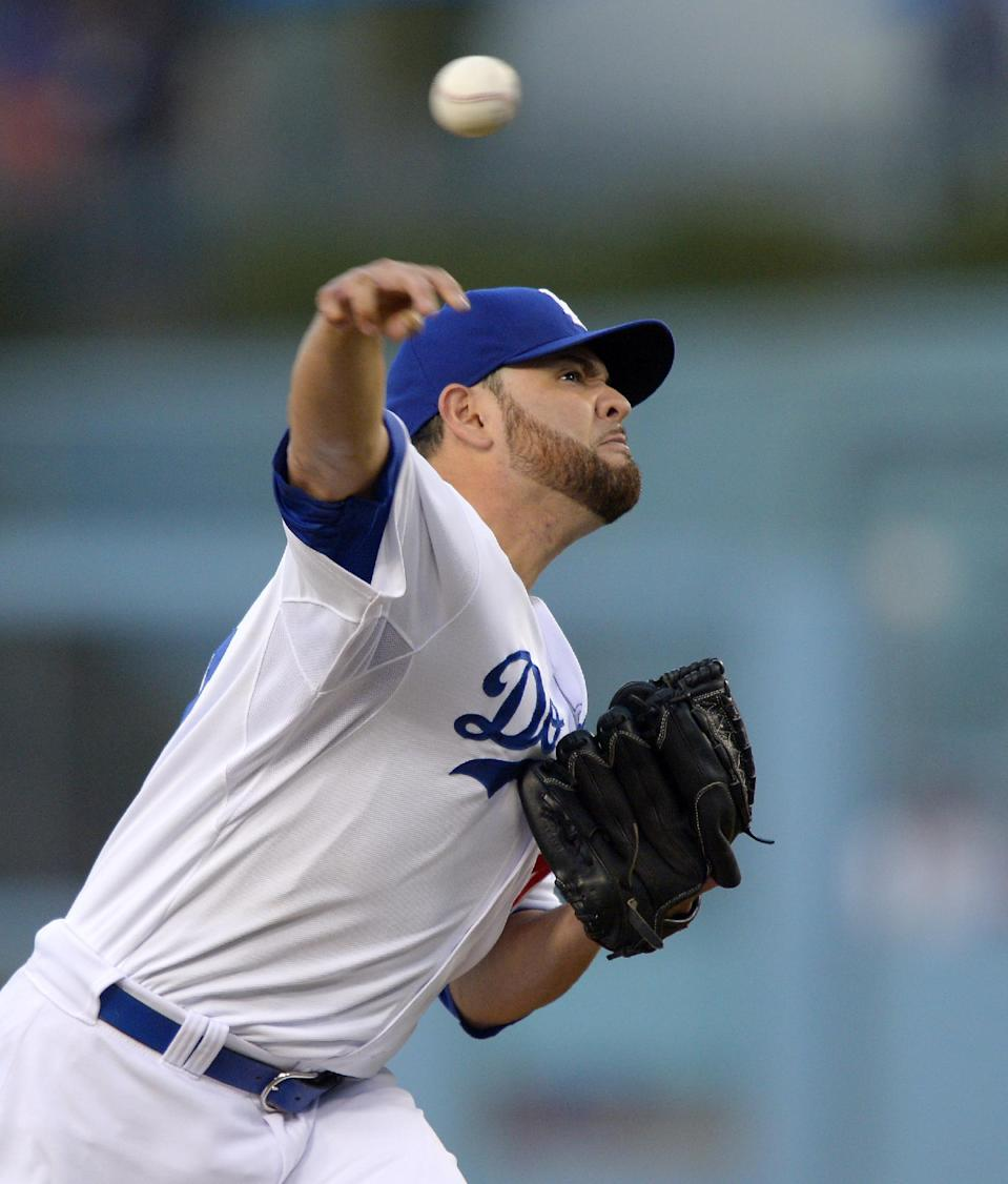 Los Angeles Dodgers starting pitcher Ricky Nolasco throws to the plate during the first inning of their baseball game against the New York Mets, Monday, Aug. 12, 2013, in Los Angeles. (AP Photo/Mark J. Terrill)