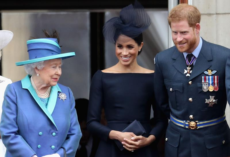 Queen Elizabeth II, Meghan Markle, and Prince Harry on Buckingham Palace balcony