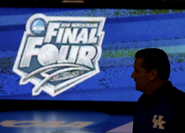 Kentucky coach John Calipari watches practice for the NCAA men's college basketball tournament Thursday, March 20, 2014, in St. Louis. Kentucky is scheduled to play Kansas State in a second-round game Friday. (AP Photo/Charlie Riedel)
