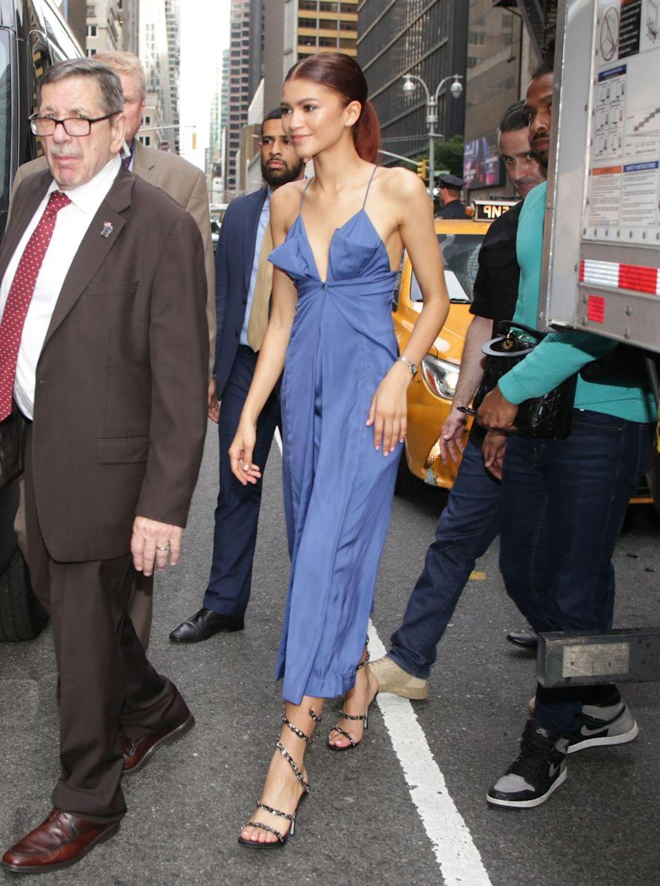 <p>A jumpsuit or dress in a chambray fabric instantly makes it feel so summer. Zendaya elevated hers with strappy, studded heels.</p>