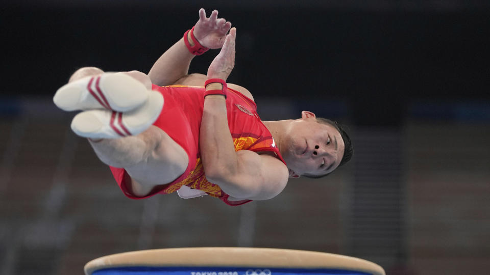 <p>Xiao Ruoteng, of China, performs on the vault during the artistic gymnastics men's all-around final at the 2020 Summer Olympics, Wednesday, July 28, 2021, in Tokyo. (AP Photo/Natacha Pisarenko)</p>