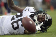 Jacksonville Jaguars cornerback Shaquill Griffin (26) can't quite hang on to a possible interception during the first half of an NFL football game against the Denver Broncos, Sunday, Sept. 19, 2021, in Jacksonville, Fla. (AP Photo/Phelan M. Ebenhack)