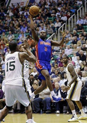 Detroit Pistons' Rodney Stuckey (3) lays the ball up as Utah Jazz's Derrick Favors (15) watches in the first quarter of an NBA basketball game, Monday, March 11, 2013, in Salt Lake City. (AP Photo/Rick Bowmer)