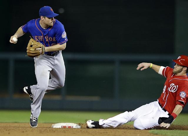 New York Mets second baseman Daniel Murphy (28) prepares to throw to first base to complete the double play, after getting the out on Washington Nationals' Bryce Harper during the third inning of a baseball game at Nationals Park, Sunday, Sept. 1, 2013, in Washington. (AP Photo/Alex Brandon)