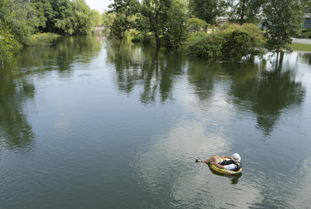 <p>Joman Schachter makes his way down the Yahara River in an inner tube just past the bridge on East Johnson Street in Madison, Wis., Thursday, Aug. 23, 2018. Schachter hoped to float all the way home, which is near Olbrich. (AP Photo/Wisconsin State Journal, Amber Arnold) </p>