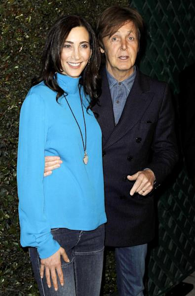 """FILE - This April 13, 2012 file photo shows Paul McCartney, right, and his wife Nancy Shevell at the world premiere of the music video for McCartney's song, """"My Valentine"""", in West Hollywood, Calif. Local media outlets report that the former Beatle accompanied his wife, Nancy Shevell, during her visit to the Syracuse, N.Y. area Wednesday, Sept. 5, for a business meeting at New England Motor Freight's operations in suburban DeWitt. Shevell is the vice president of administration for the company owned by her father, Myron Shevell. The reports say McCartney and Nancy Shevell flew into Syracuse on a private jet and spent several hours in the area, including having lunch with company employees. Photos of McCartney with groups of workers have been posted on Facebook pages and Syracuse media websites. (AP Photo/Matt Sayles, file)"""