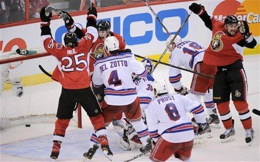Ottawa Senators' Chris Neil (25), left, Kyle Turris, rear left, and Nick Foligno, right, celebrate a goal by Sergei Gonchar, not shown, as New York Rangers' Michael Del Zotto (4), goalie Henrik Lundqvist (30), Brandon Prust (8) and Marc Staal watch during the second period of Game 4 of a first-round NHL hockey Stanley Cup playoff series against the Ottawa Senators in Ottawa, Ontario, Wednesday, April 18, 2012. (AP Photo/The Canadian Press, Sean Kilpatrick)
