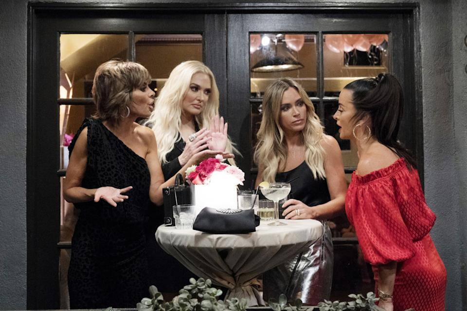 Erika Jayne, second from left, and three women gather around a cocktail table.