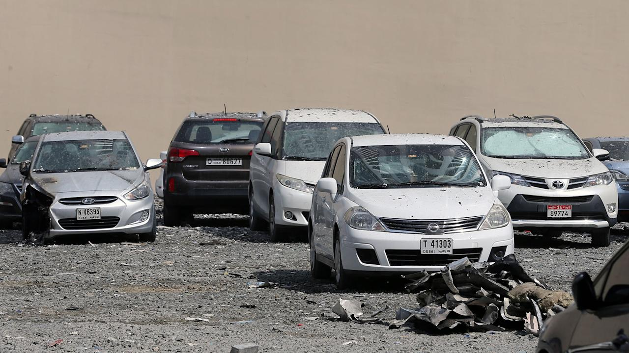 "<p>A picture taken on August 4, 2017 shows parked cars damaged by the fire that hit ""The Torch"", one of the tallest towers in Dubai, early in the morning. (Photo: Karim Sahib/AFP/Getty Images) </p>"