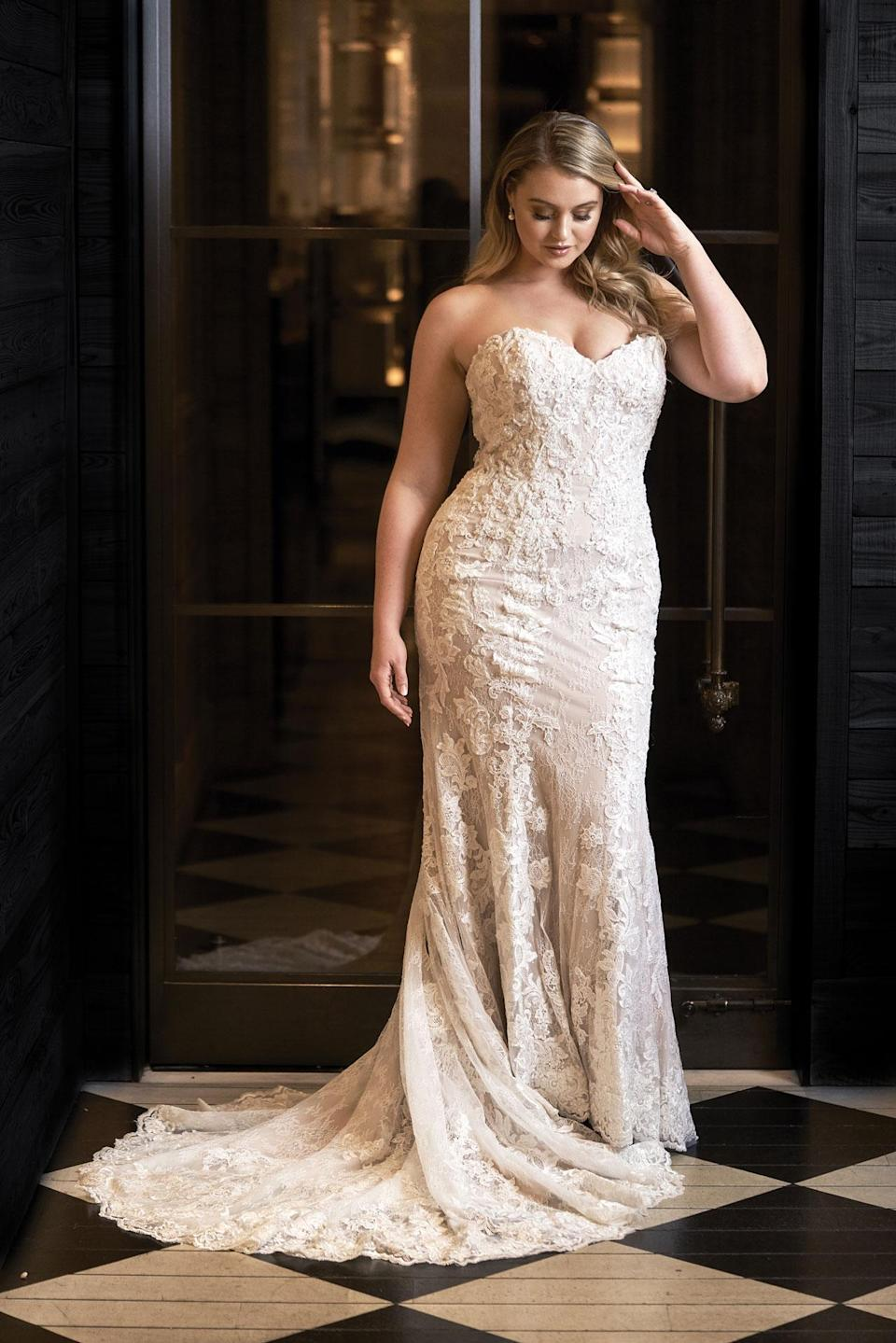 <p>Lawrence wears a strapless lace gown by Justin Alexander. (Photo: courtesy of Justin Alexander) </p>