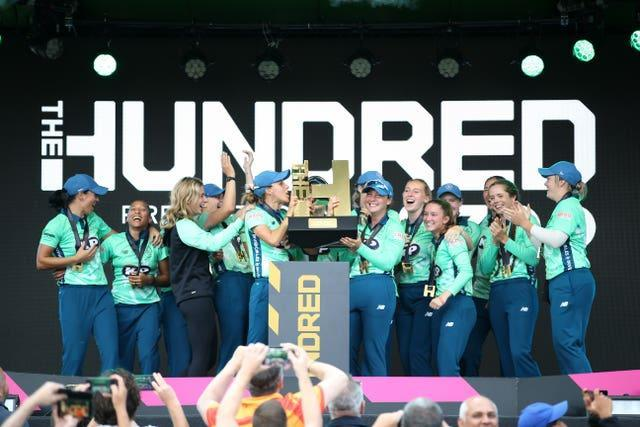 Oval Invincibles players lift the Hundred trophy