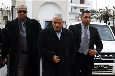 Hussein Abassi (C), head of the Tunisian General Labour Union (UGTT), arrives at a meeting in Tunis December 23, 2013. REUTERS/Zoubeir Souissi
