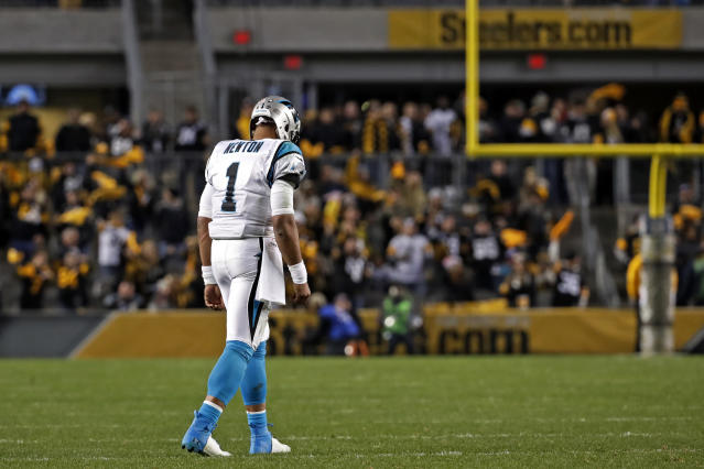 Carolina Panthers quarterback Cam Newton walks onto the field during the second half of the team's NFL football game against the Pittsburgh Steelers in Pittsburgh, Thursday, Nov. 8, 2018. The Steelers won 52-21. (AP Photo/Don Wright)