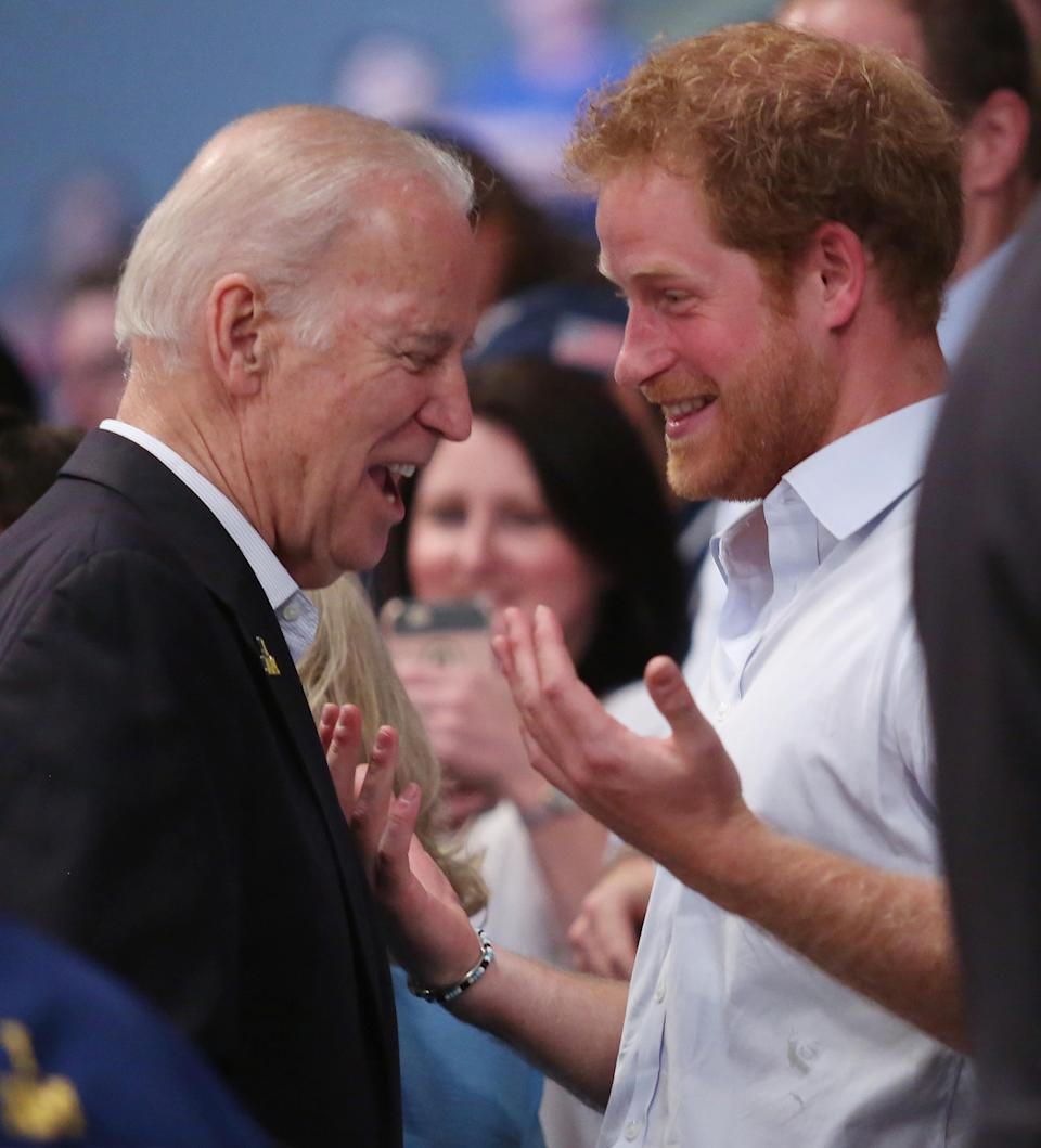 Vice President Joe Biden shares a moment with Prince Harry during the gold medal wheelchair rugby gold medal match of USA against Denmark at the Invictus Gams