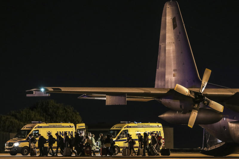 Seventeen Portuguese and two Brazilian citizens returning from the virus-hit city of Wuhan disembark from a Portuguese Air Force C-130 airplane at a military airport in Lisbon. Source: AP
