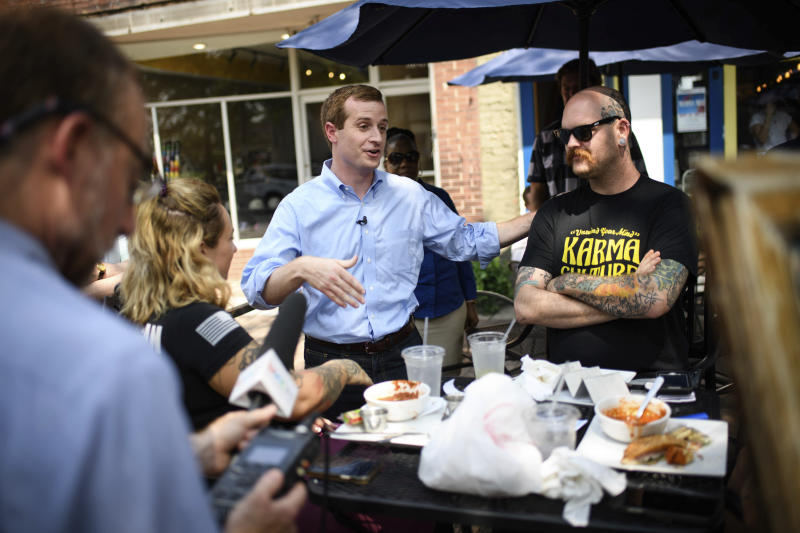 Dan McCready, a Democratic candidate for North Carolina's 9th District, talks to Johnny Ivey while campaigning on Hay Street on Monday, Sept. 9, 2019, in Fayetteville, N.C. (Andrew Craft/The Fayetteville Observer via AP)