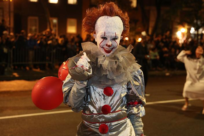 A reveler dressed as the terrifying Pennywise marches during the Halloween Parade in New York City. (Photo: Gordon Donovan/Yahoo News)