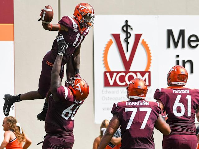 <p>Wide receiver Tré Turner #11 of the Virginia Tech Hokies is lifted up following his touchdown reception against Furman by offensive lineman Silas Dzansi #60 in the second half at Lane Stadium.</p>