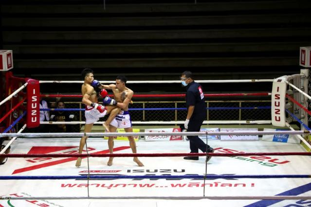 Muaythai boxers return to fight for the first time after temporary suspend due to the spread of the coronavirus disease (COVID-19) in Thailand