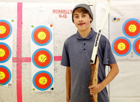 FILE PHOTO: Joshua Lemacks, 14, who has a congenital heart defect, stands for a portrait during archery practice in Richmond, Virginia, U.S. November 18, 2017.  REUTERS/Julia Rendleman/File Photo