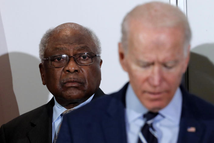 "FILE - In this Feb. 26, 2020 file photo, House Majority Whip, Rep. Jim Clyburn, D-S.C., background, listens as Democratic presidential candidate former Vice President Joe Biden, speaks at an event where Clyburn endorsed him in North Charleston, S.C. ""What I think we need to do now is support this new administration that seems to have leadership as a part of his agenda,"" said Clyburn, a close ally of Biden. ""We are where we are today because of a lack of leadership and I think that Joe Biden has demonstrated in his articulations that he's prepared to provide the kind of leadership that we need."" (AP Photo/Gerald Herbert, File)"