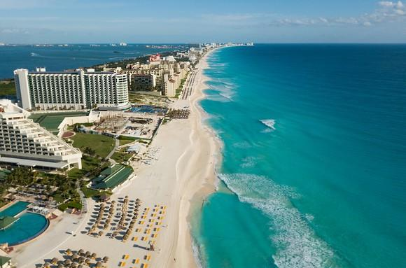 Arial view of beachfront hotels.