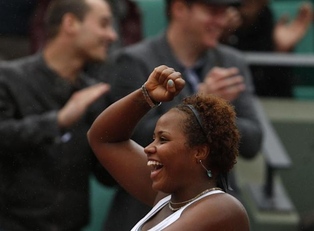 Taylor Townsend, of the U.S, reacts as she defeats France's Alize Cornet after their second round match of the French Open tennis tournament at the Roland Garros stadium, in Paris, France, Wednesday, May 28, 2014. (AP Photo/Darko Vojinovic)