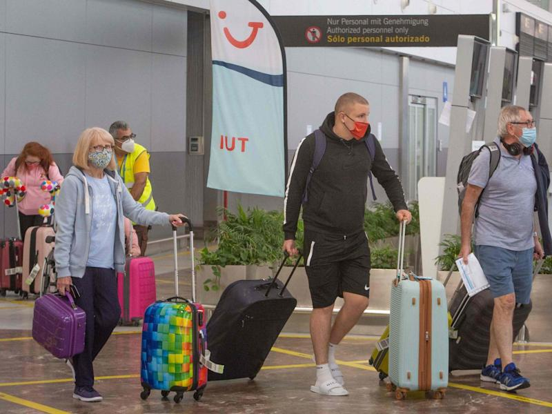 British tourists arrive in Tenerife on 28 July: AFP/Getty