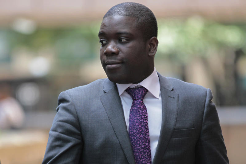 FILE This Tuesday, Sept. 18, 2012 file photo shows former trader Kweku Adoboli leaving Southwark Crown Court in London for a lunch break from his trial at the court.  A rogue trader who lost $2.2 billion in bad deals at Swiss bank UBS was convicted of fraud on Tuesday, Nov. 20, 2012. Ghanaian-born Kweku Adoboli, 32, exceeded his trading limits and failed to hedge trades, allegedly faking records to cover his tracks at the bank's London office. At one point, Adoboli risked running losses of up to $12 billion. The fraud conviction carries a maximum jail term of 10 years. (AP Photo/Sang Tan)