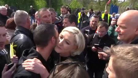 Marine Le Pen, French National Front (FN) political party candidate for French 2017 presidential election, kisses an employee, in this still picture taken from video, as she visits Whirlpool employees in front of the company plant in Amiens