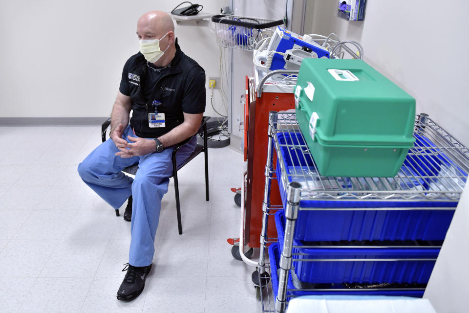 Emergency Department Nurse Paul Murphy at Brigham and Women's Hospital in Boston, Thursday, June 3, 2021. States, such as Massachusetts, with high vaccination rates are reporting plunging COVID-19 cases, multiple days without deaths and health care workers who've gone weeks without treating a patient. (AP Photo/Josh Reynolds)