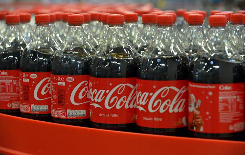 The worker put the bottles of coke in a rucksack after they fell out (AFP/Getty Images)