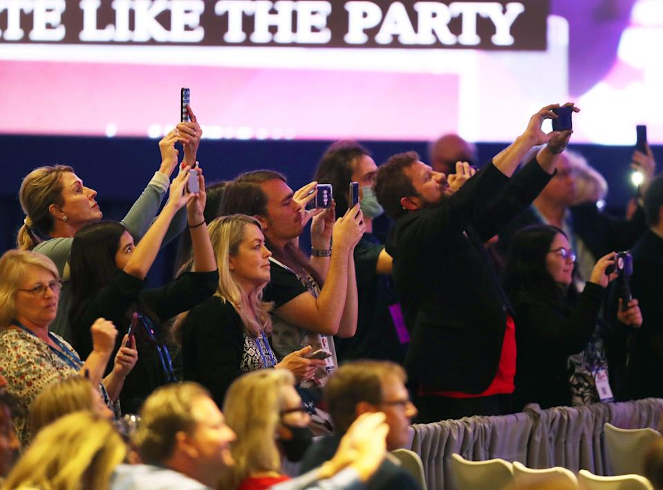maskless people at CPAC