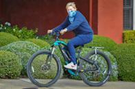 <p>Ellen DeGeneres hops on her bike after lunching with friends in Santa Barbara, California, on Monday.</p>