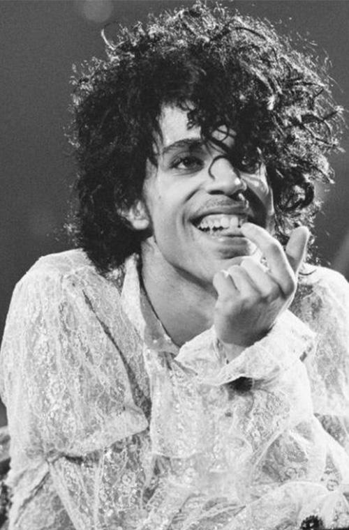 Prince's larger then life hair. Prince slayed it in white frilled lace at California's fabulous forum.