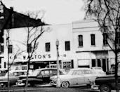 """<p>In the 1960s, Sam owned nine Ben Franklin stores but viewed the concept of variety stores as limiting. He decided that discount stores were the future. In 1962, he opened his first """"Wal-Mart Discount City"""" in Rogers, Arkansas.</p><p>Photo: Courtesy of The Walmart Museum</p>"""