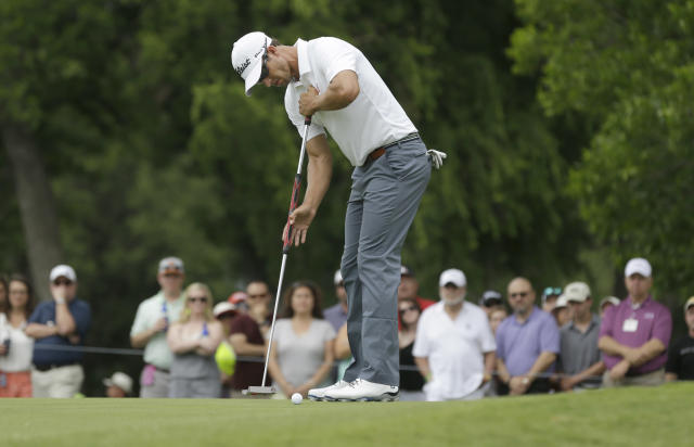 Adam Scott putts on the second hole during the final round of the PGA Colonial golf tournament in Fort Worth, Texas, Sunday, May 25, 2014. (AP Photo/LM Otero)
