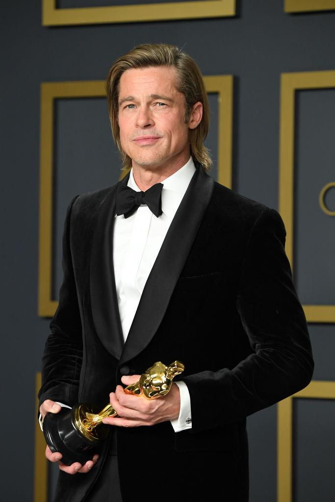 """Early 2020 proved fruitful for <a href=""""https://ca.search.yahoo.com/search?p=BradPitt&fr=fp-tts&fr2"""" data-ylk=""""slk:Brad Pitt"""" class=""""link rapid-noclick-resp"""">Brad Pitt</a>, who nabbed both a Golden Globe and Academy Award for his role in """"Once Upon A Time...In Hollywood."""" Aside from a successful awards ceremony, Pitt delighted fans in January when he was photographed embracing ex-wife, <a href=""""https://ca.search.yahoo.com/search?p=JenniferAniston&fr=fp-tts&fr2"""" data-ylk=""""slk:Jennifer Aniston"""" class=""""link rapid-noclick-resp"""">Jennifer Aniston</a>, at the Screen Actors Guild Awards. The 57-year-old made headlines throughout the year for his appearance on """"Saturday Night Live"""" as Dr. Anthony Fauci, which earned him an Emmy nomination, and his rumoured new relationship with German model, Nicole Potularski."""