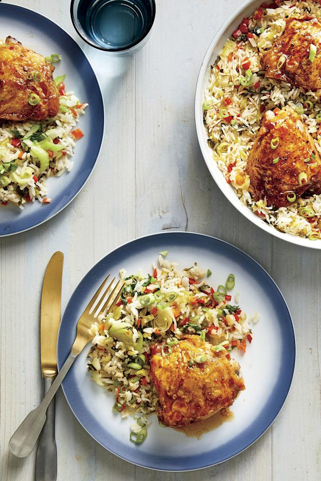 """<p><b>Recipe: </b><a href=""""https://www.southernliving.com/recipes/hot-honey-chicken-rice""""><strong>One-Pan Hot Honey Chicken and Rice</strong></a></p> <p>Golden brown, honey-chile chicken thighs steal the show in this dish.</p>"""
