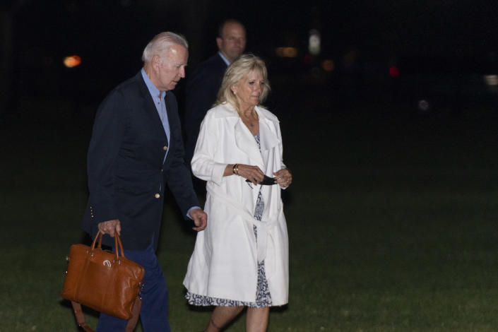President Joe Biden and first lady Jill Biden walk on the Ellipse near the White House in Washington, as they arrive from a weekend trip to their house in Wilmington, Del., late Sunday, June 20, 2021. (AP Photo/Manuel Balce Ceneta)