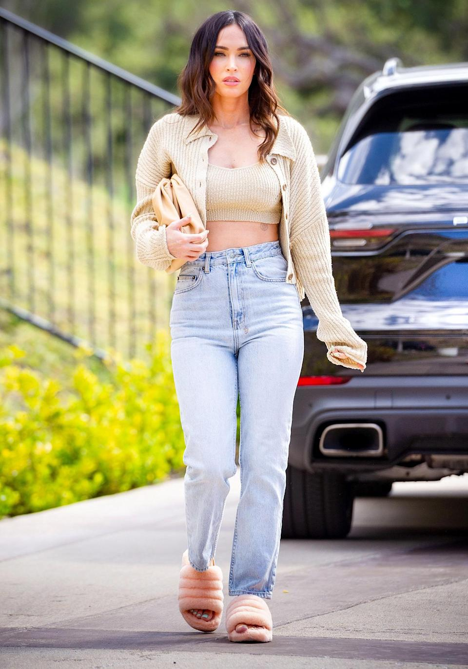<p>Megan Fox looks gorgeous as she steps out in a cropped top, sweater and jeans while out in L.A. on Thursday.</p>