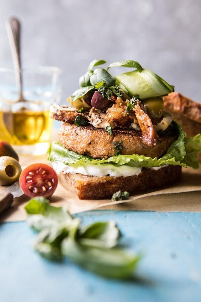 """<a href=""""https://www.halfbakedharvest.com/greek-roasted-cauliflower-burgers-with-pan-fried-feta-and-tomato-olive-salsa/"""" rel=""""nofollow noopener"""" target=""""_blank"""" data-ylk=""""slk:Get the recipe for Greek Roasted Cauliflower Burgers from Half Baked Harvest"""" class=""""link rapid-noclick-resp""""><strong>Get the recipe for Greek Roasted Cauliflower Burgers from Half Baked Harvest</strong></a>"""