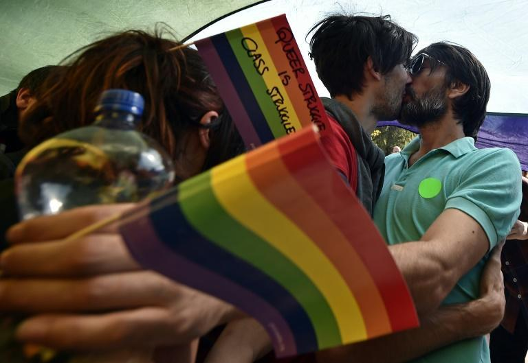 A gay couple kiss during the Pride Parade in Belgrade in 2014