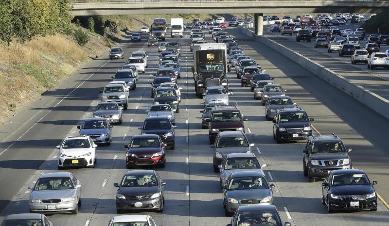FILE - In this Monday, Oct. 30, 2017, file photo, vehicles crowd Highway 50 in Sacramento, Calif. California Attorney General Xavier Becerra announced, Friday Sept. 20, 2019 that 23 states have filed a lawsuit to stop the Trump administration from revoking California's authority to set emission standards for cars and trucks. (AP Photo/Rich Pedroncelli, File)